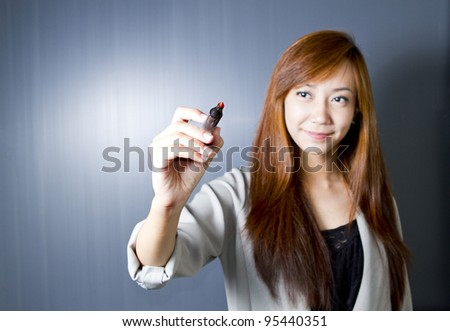 Woman drawing something on screen with a pen.