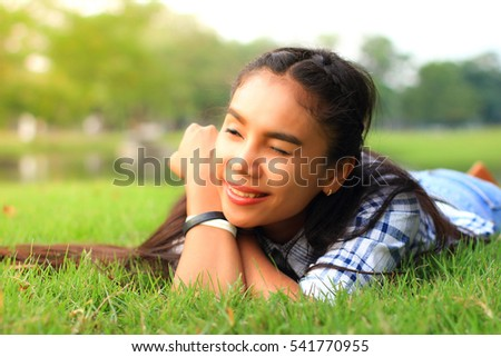 woman dreaming happily in park