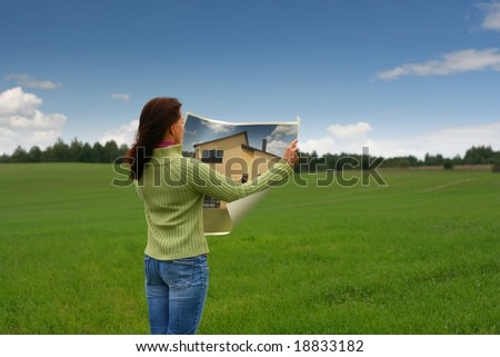 Woman dreaming of new house - stock photo