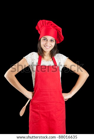 Woman dressed as a cook over black backgound - stock photo