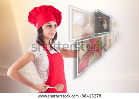 Woman dressed as a cook selecting images - stock photo