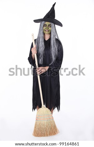 Woman dressed as witch - stock photo