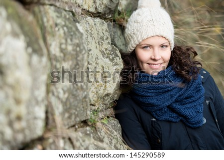 Woman dressed for cold weather with wool hat and scarf - stock photo