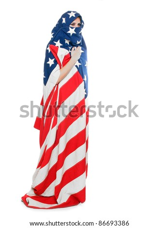Woman dressed in american flag. Censor and freedom of speech concept. Media prisoner and human rights concept. - stock photo