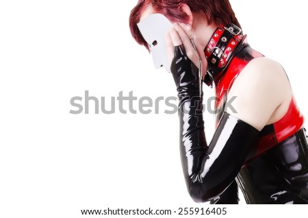 Woman dressed in dominatrix clothes - stock photo