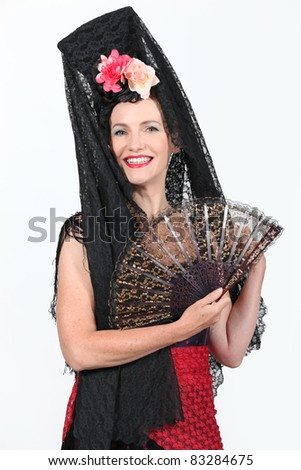 woman dressed in traditional Spanish outfit - stock photo