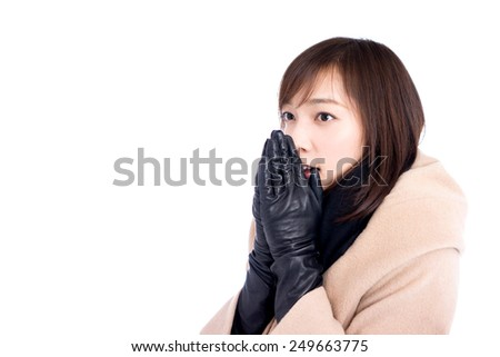 Woman dressed with wool coat and scarf, isolated on white background - stock photo