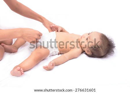 woman dresses to the baby diaper - stock photo