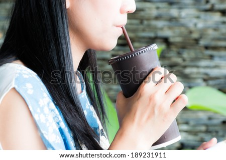 Woman drink coffee by pipe - stock photo