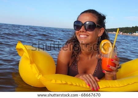 Woman drink fresh summer cocktail - stock photo