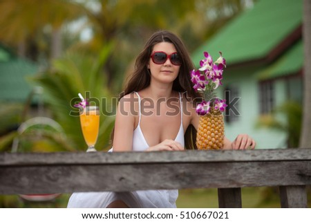 woman drink juice from pineapple