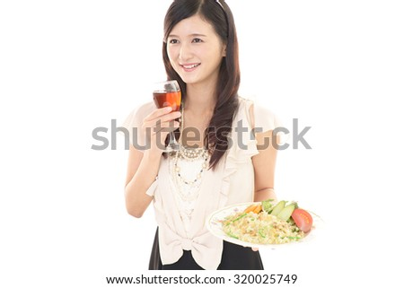 Woman drinking a glass of wine
