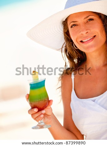 Woman drinking a tropical cocktail while on vacations - stock photo