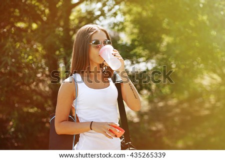 Woman drinking at the outdoor water before working out . Girl close-up, drink water - stock photo