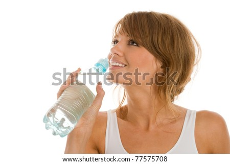Woman drinking bottled mineral water - stock photo