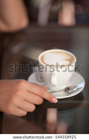 woman drinking coffee at cafe restaurant girl with cup of espresso hot cappuccino. Woman with mug of chocolate with caffeine. Coffee for breakfast. Italian coffee. delicious drink aroma latte. Concept - stock photo