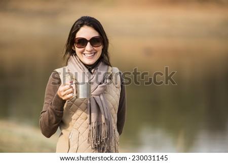 woman drinking coffee in a safari. - stock photo