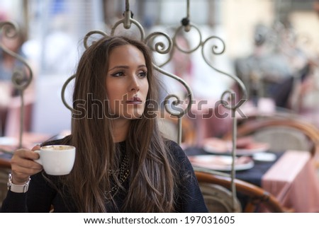 Woman drinking coffee in coffe shop and waiting for her boyfriend - stock photo