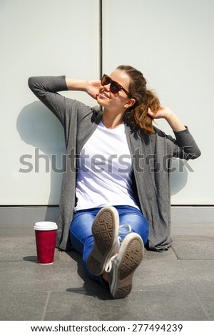 woman drinking coffee in the morning at street relax - stock photo