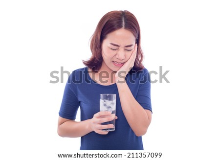 woman drinking cold drink, glass full of ice cubes and feels toothache, pain
