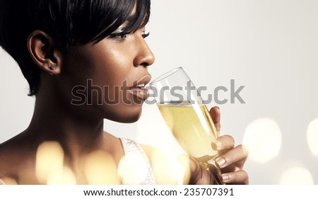 woman drinking from champagne glass. bokeh below - stock photo