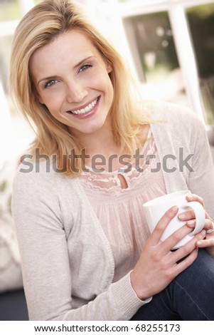 Woman drinking from cup - stock photo
