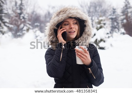 Woman drinking her hot beverage from cup. Winter season.