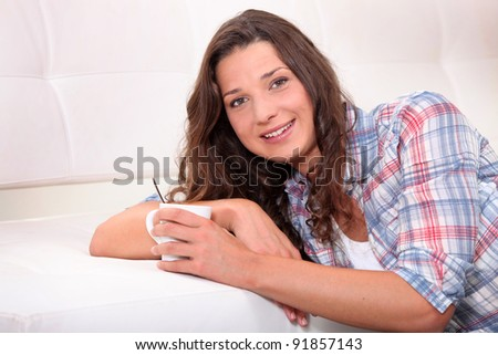Woman drinking hot drink - stock photo