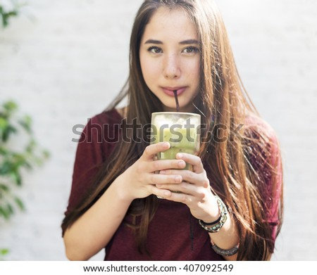 Woman Drinking Iced Green Tea Concept - stock photo