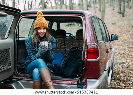 Woman drinking in off road vehicle.