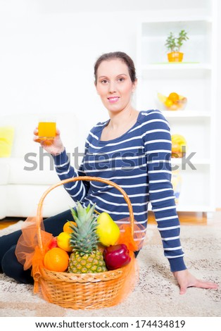 woman drinking juice at home - stock photo