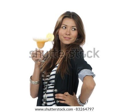 Woman drinking margarita cocktail. Pretty brunette lady holding popular orange margaritas cocktails drink glass with lemon in right hand isolated on a white background - stock photo