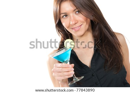 Woman drinking martini cocktail. Pretty brunette lady holding popular blue tropical martinis glass with lime in right hand in black shirt isolated on a white background - stock photo
