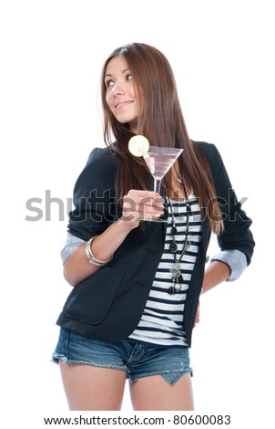 Woman drinking martini cocktail. Pretty brunette lady holding popular pink cosmopolitan cocktails drink glass with lemon in right hand isolated on a white background