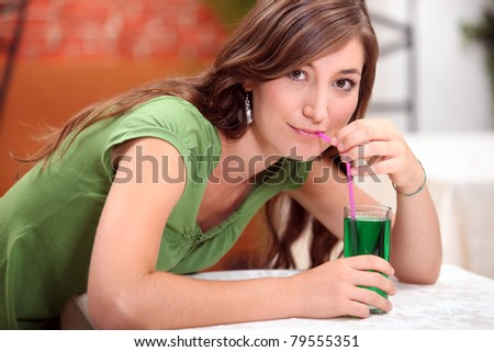 Woman drinking mint flavored water