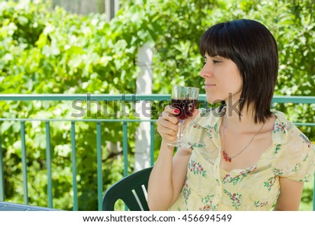 woman drinking red wine in a vineyard, outdoor - stock photo