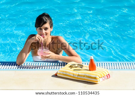 Woman drinking soda in swimming pool. Caucasian beautiful girl into water on summer. Copy space. - stock photo