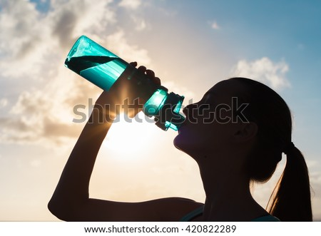 Woman drinking water.  - stock photo