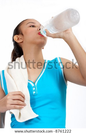 woman drinking water after playing badminton - isolated on white - stock photo