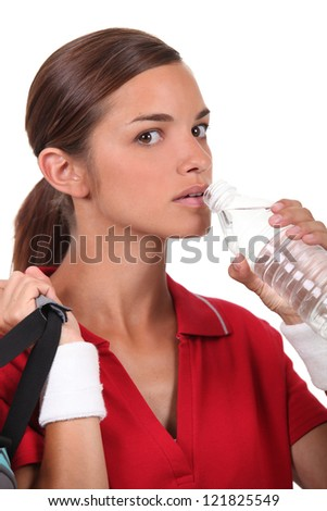 Woman drinking water after sport - stock photo