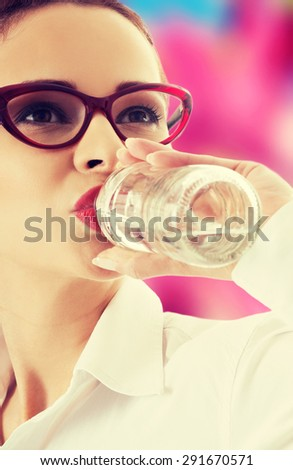 Woman drinking water from bottle - stock photo