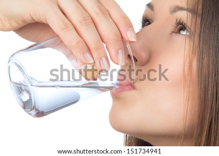 Woman drinking water isolated against white background - stock photo