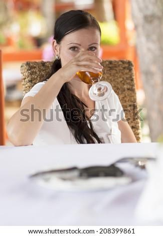 Woman drinking wine.  - stock photo
