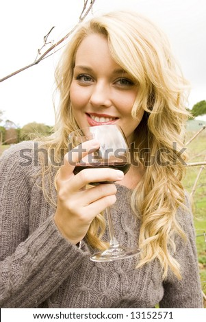 woman drinking wine at the vineyard - stock photo