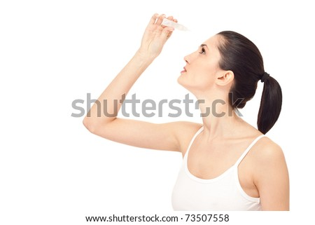 woman dripping eye with eyes drops, isolated on white, close up - stock photo