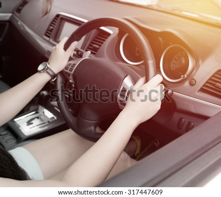woman driver driving a car . vintage tone style
