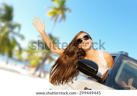 Woman driver showing hand. Concept of traveling. Beautiful caucasian young woman. - stock photo
