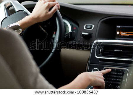 woman driving a car - stock photo