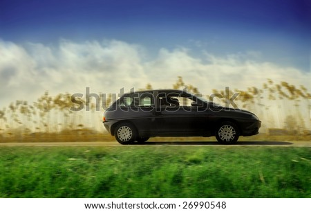 woman driving a car in the nature