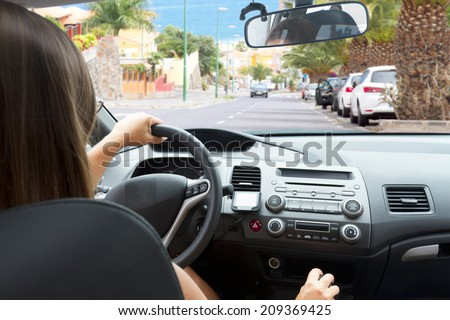 woman driving a car, view  inside out - stock photo